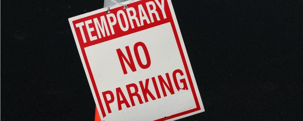 parking lot sign during repaving