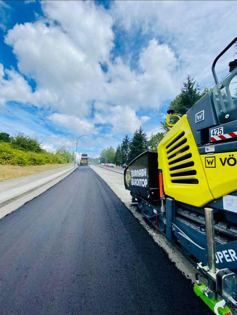 burnaby blacktop equipment besides a freshly paved road