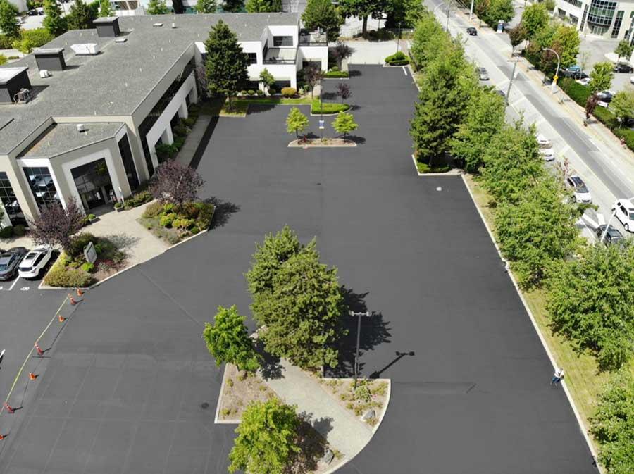 parking lot, no cars, new seal coating