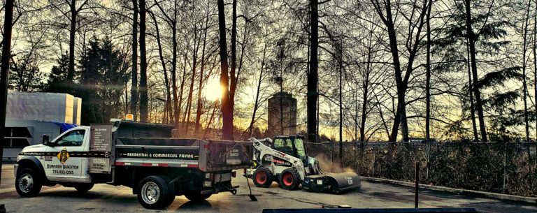 small dump truck and paver