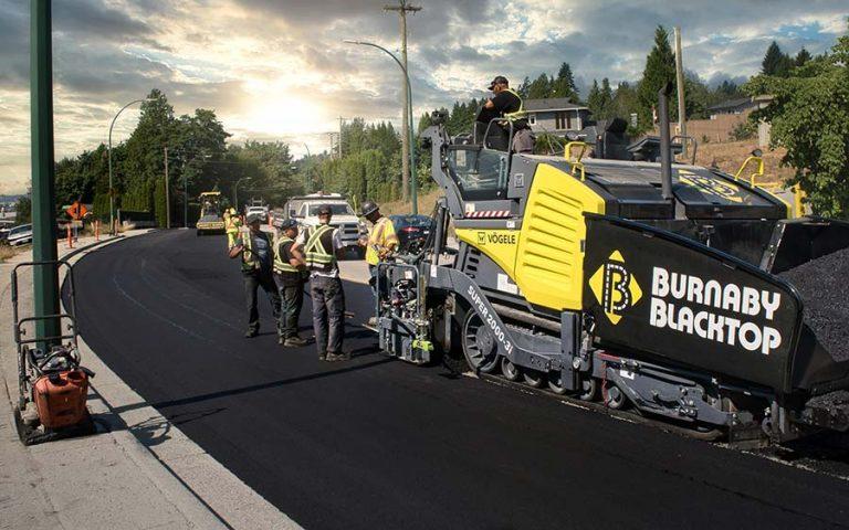burnaby blacktop truck besides freshly asphalt pavement